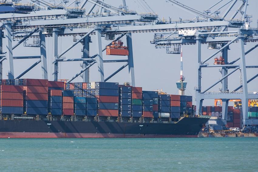 Large dock cranes unloading a large cargo ship