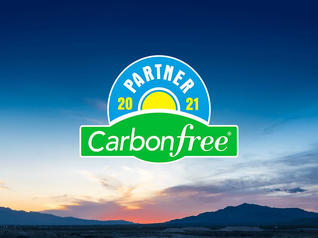 Carbonfree Partner 2021 badge with sunset background